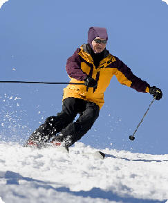 Man Skiing with Plum's® ProtectaCap+Plus® Fall Protection Helmet